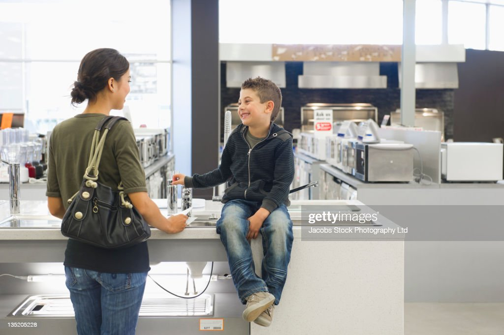 Hispanic mother and son in home supply store