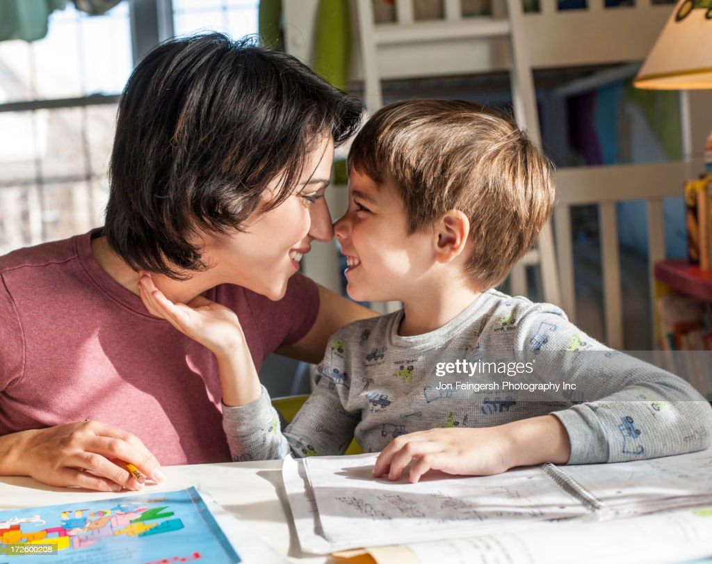 Hispanic mother and son touching noses