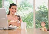 Hispanic mother holding baby