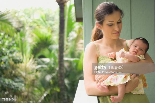 Hispanic mother holding baby