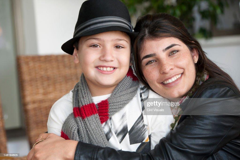 Hispanic mother hugging son