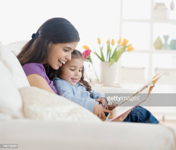 Hispanic mother reading to daughter