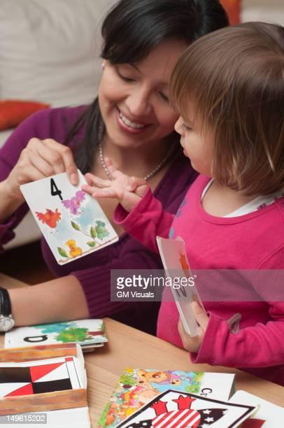 Hispanic mother teaching daughter numbers