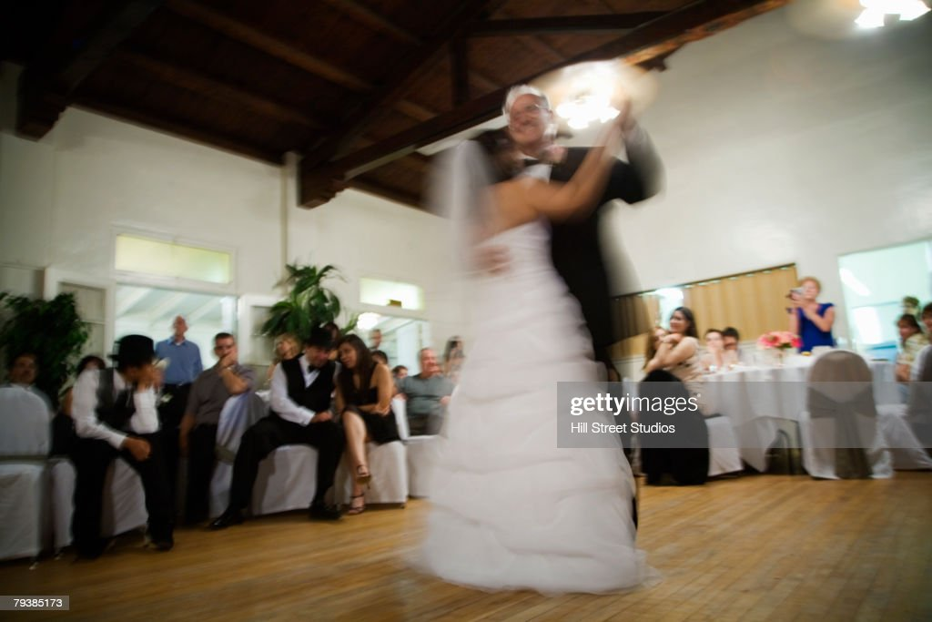 Hispanic newlyweds dancing