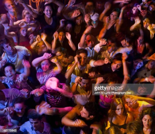 Hispanic people dancing in nightclub