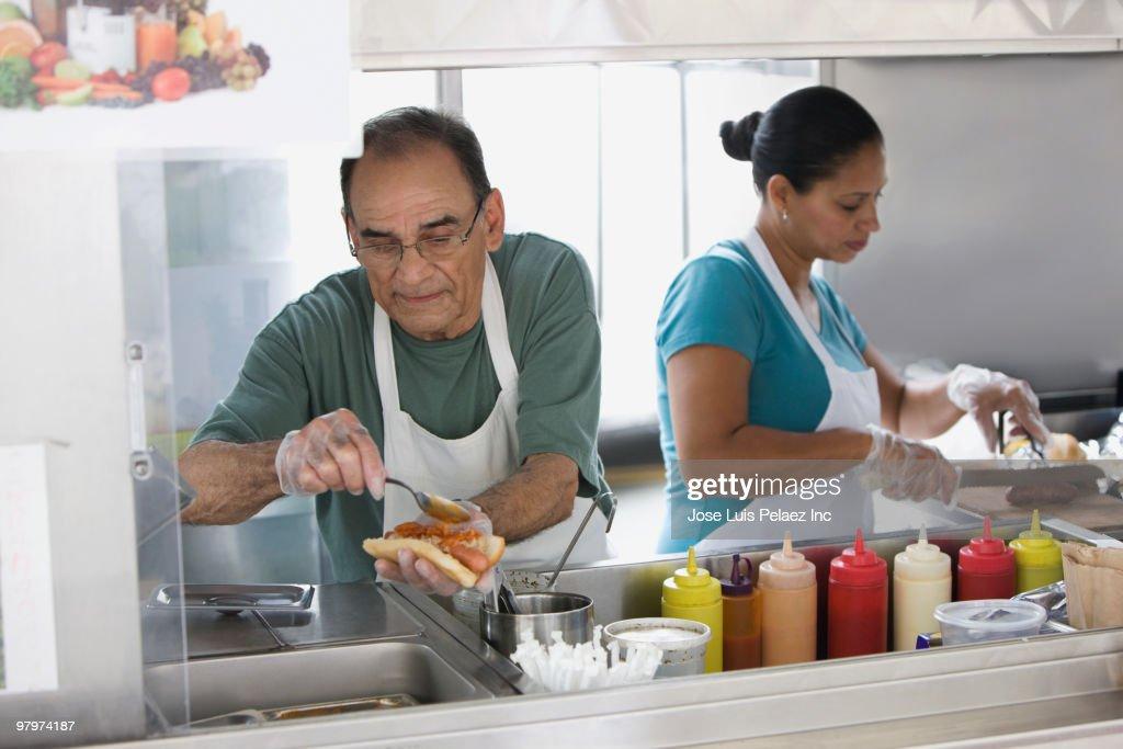 Hispanic people working in food cart