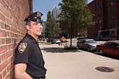 Hispanic police officer on New York City Street