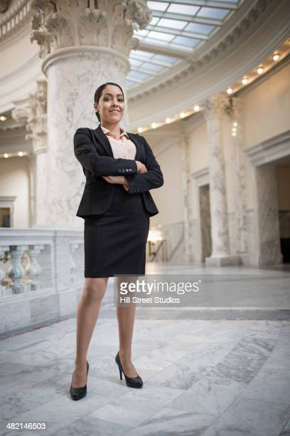 Hispanic politician standing in government building