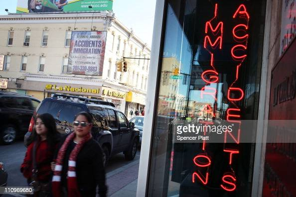 Hispanic residents walk by a law office specializing in immigration on March 28 2011 in Union City New Jersey Union City New Jersey one of the...
