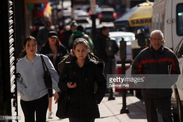 Hispanic residents walk down a street on March 28 2011 in Union City New Jersey Union City New Jersey one of the state's largest cities has a...