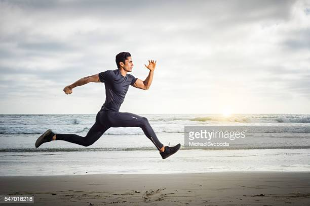 Hispanic Runner On The Beach