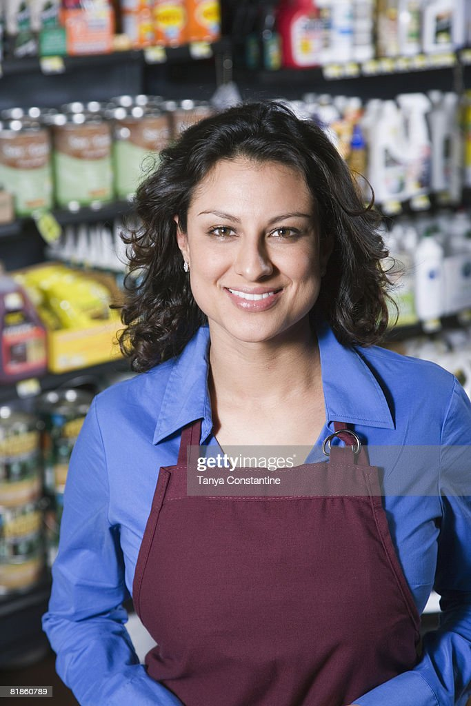 Hispanic sales clerk in hardware store : Stock Photo