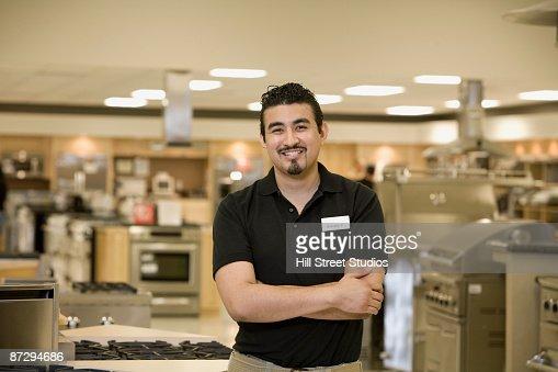Hispanic salesman in appliance showroom