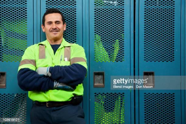 Hispanic sanitation worker in locker room