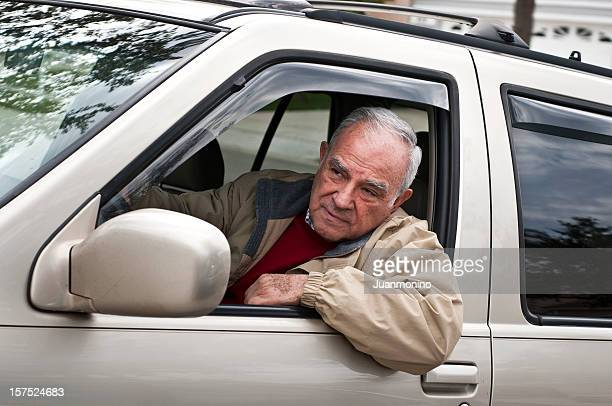 Hispanic senior man driving his SUV