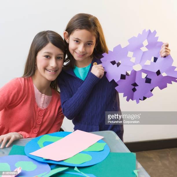Hispanic sisters doing art project
