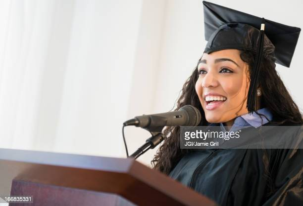 Hispanic student giving speech at graduation