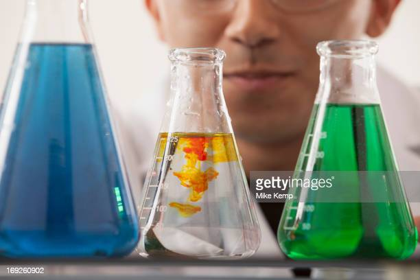 Hispanic student working in chemistry lab