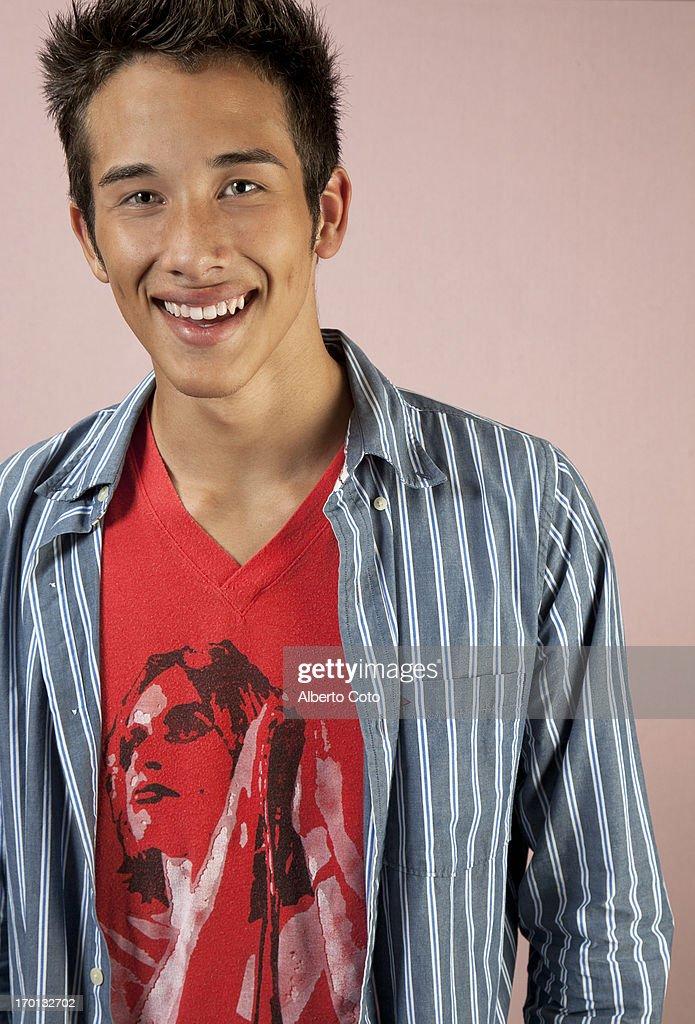 Hispanic teenage boy studio portrait : Stock Photo