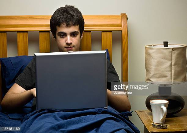 Hispanic teenager working with his lap top