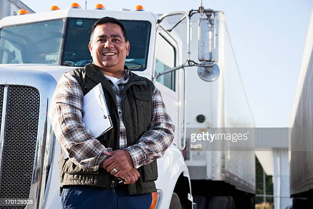 Hispanic truck driver with clipboard