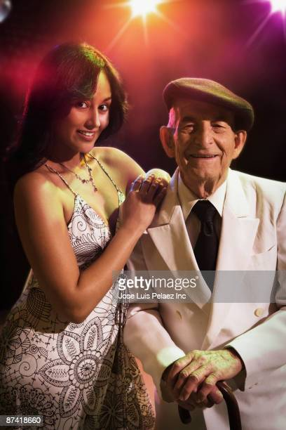 Hispanic woman and senior man in nightclub