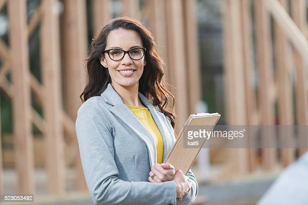 Hispanic woman at construction site