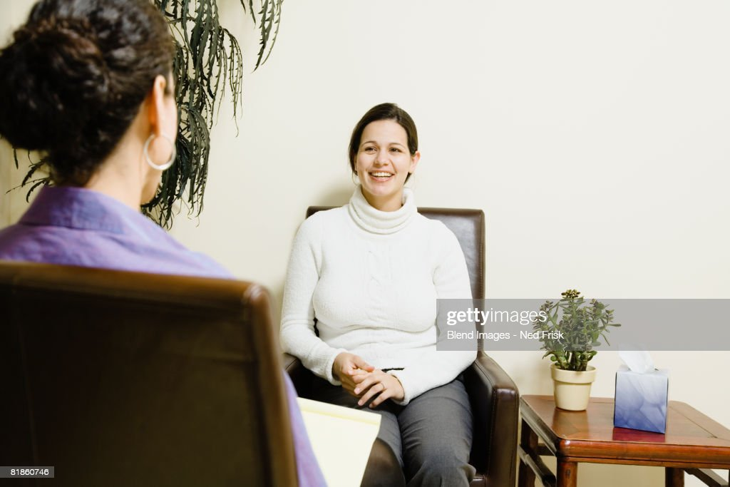 Hispanic woman at therapy session : Stock Photo