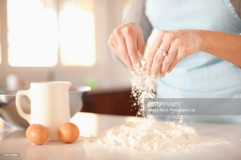 Hispanic woman baking in kitchen