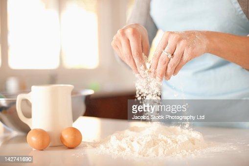 Hispanic woman baking in kitchen : Stock Photo