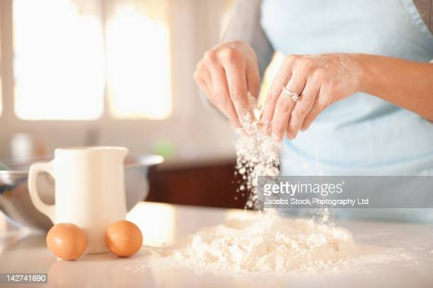 Hispanic woman baking in kitchen