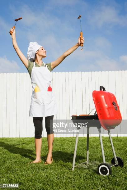 Hispanic woman barbecuing