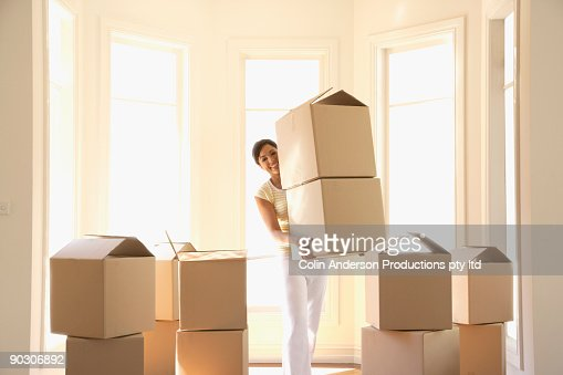 hispanic woman carrying cardboard boxes stock photo getty images. Black Bedroom Furniture Sets. Home Design Ideas