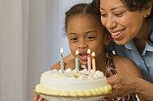Hispanic woman celebrating her daughter's birthday