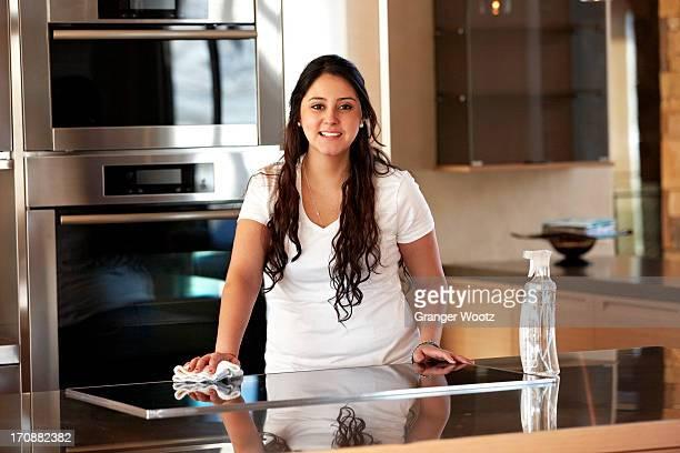Hispanic woman cleaning kitchen
