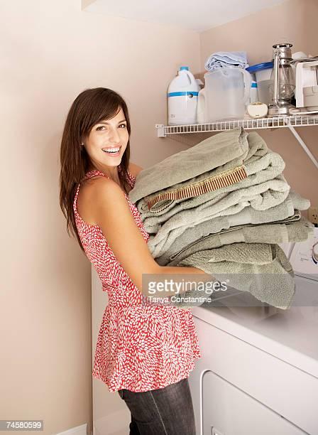 Hispanic woman doing laundry