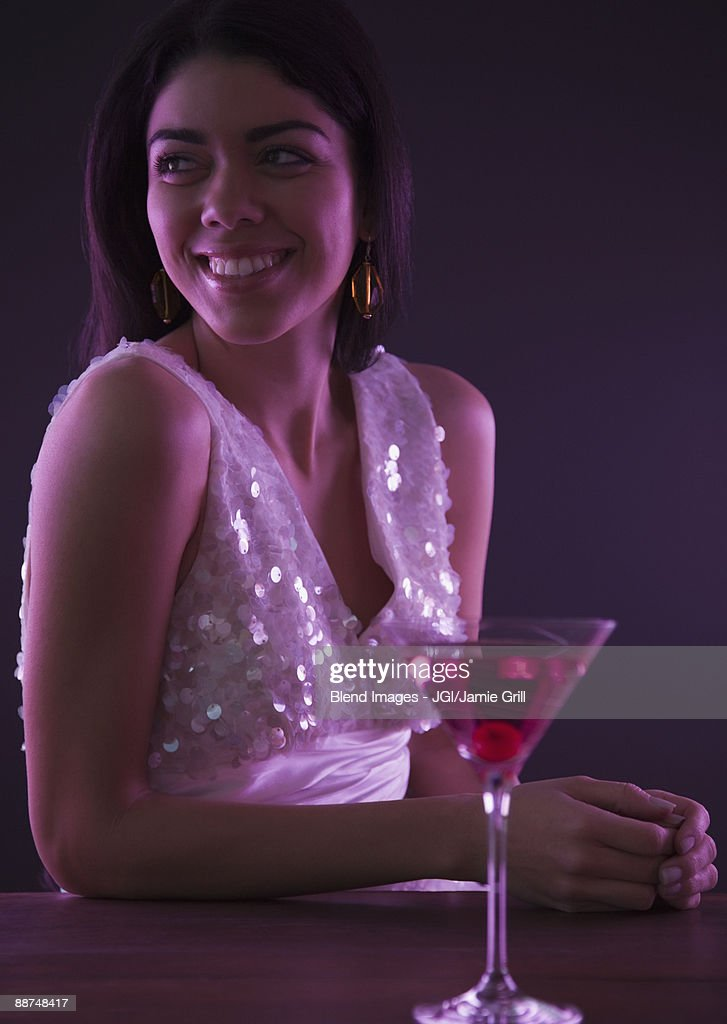 Hispanic woman drinking cocktails