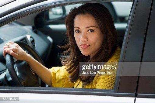Hispanic woman driving car : Stock Photo