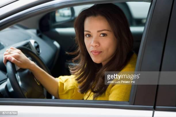 Hispanic woman driving car
