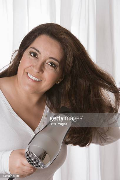 Hispanic woman drying her hair