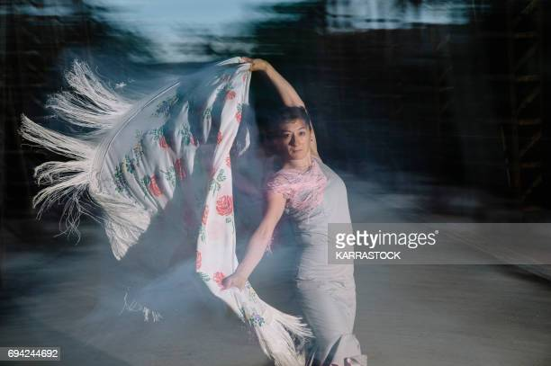 Hispanic woman flamenco dancing