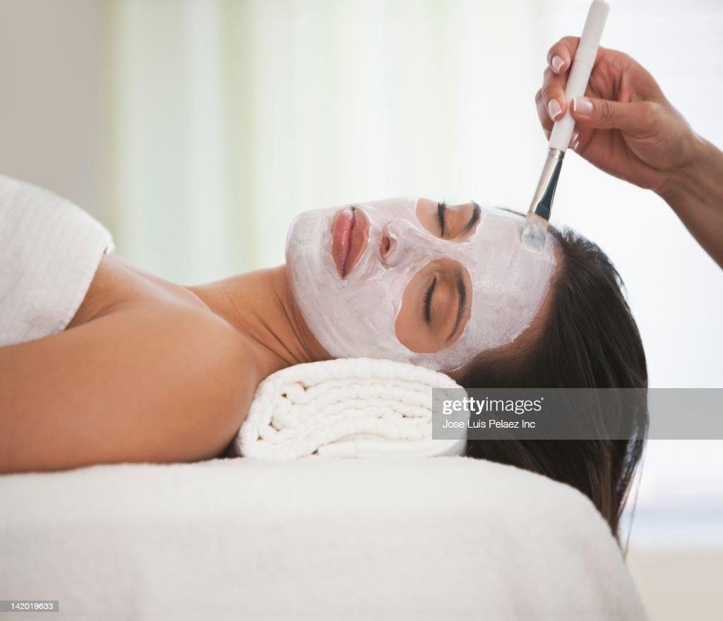Hispanic woman having facial spa treatment : Stock Photo
