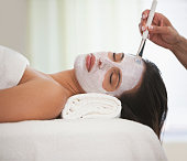 Hispanic woman having facial spa treatment
