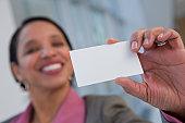 Hispanic woman holding a card
