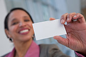 Hispanic woman holding a card