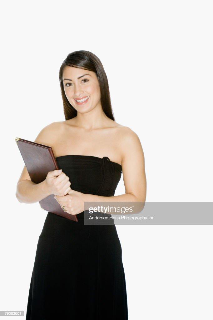 Hispanic woman holding folder