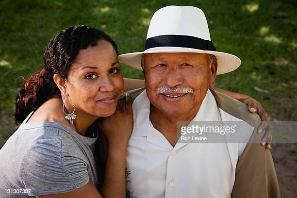 Hispanic woman hugging her father, portrait