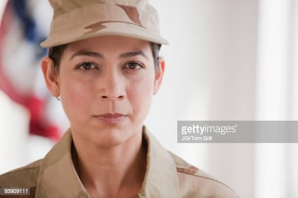 Hispanic woman in army uniform