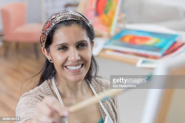 Hispanic woman in art studio