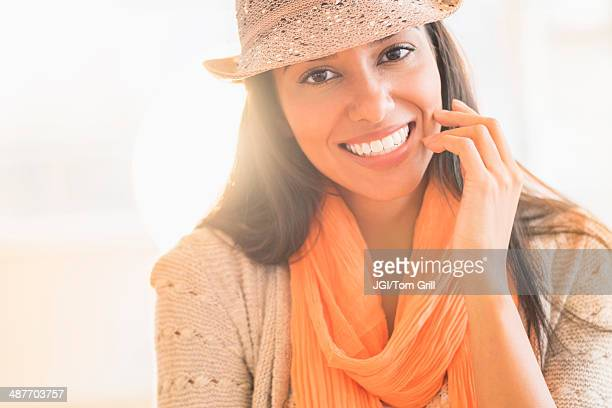 Hispanic woman in fedora and scarf